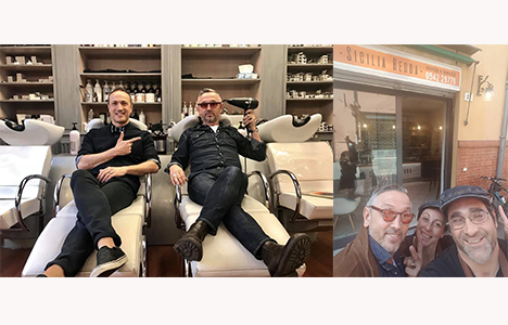 Lo chef Bruno Barbieri a Imola tra un taglio dal parrucchiere e un selfie in rosticceria