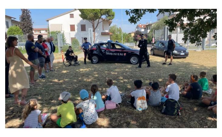 Visita dei carabinieri al centro estivo dell'Imola Rugby per promuovere la cultura della legalità